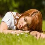 girl sleeping in a meadow